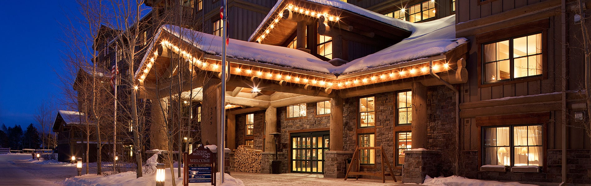Teton Mountain Lodge exterior with Christmas lights