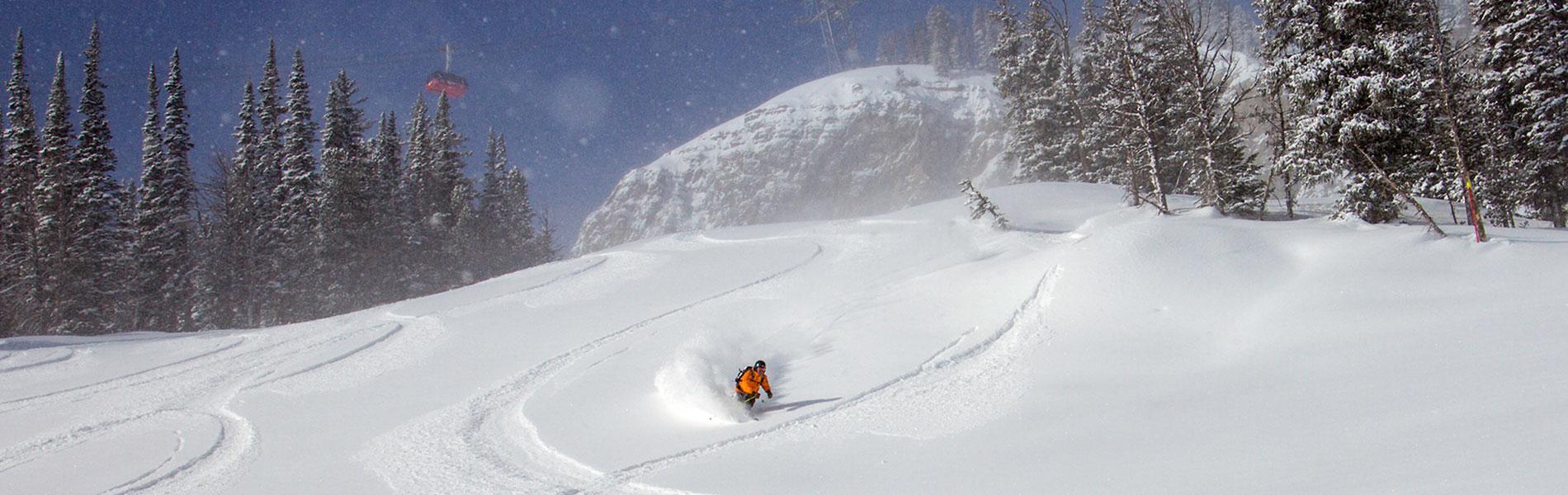 Jackson hole skier with gondola in background