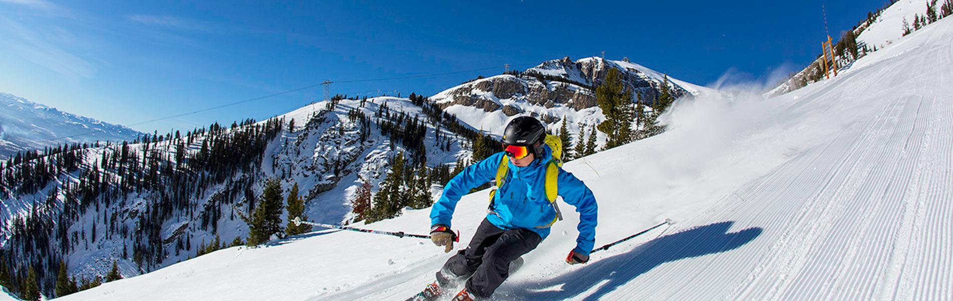 Mountain skier in soft powder