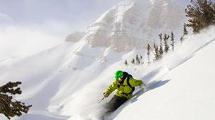 Skier on the mountainside in fresh powder