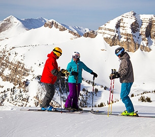 Friends chatting on ski slope