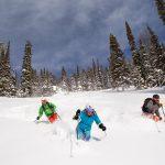 Three skiers.