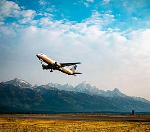 An airplane taking off near the Tetons.