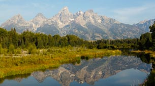 The Tetons and lake in the spring.