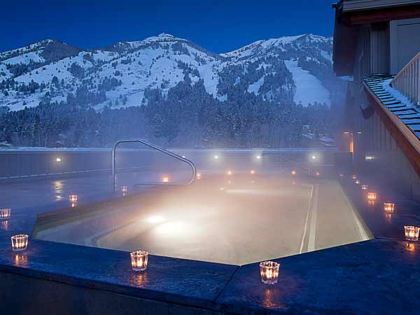 Misty heated outdoor pool in the snow.