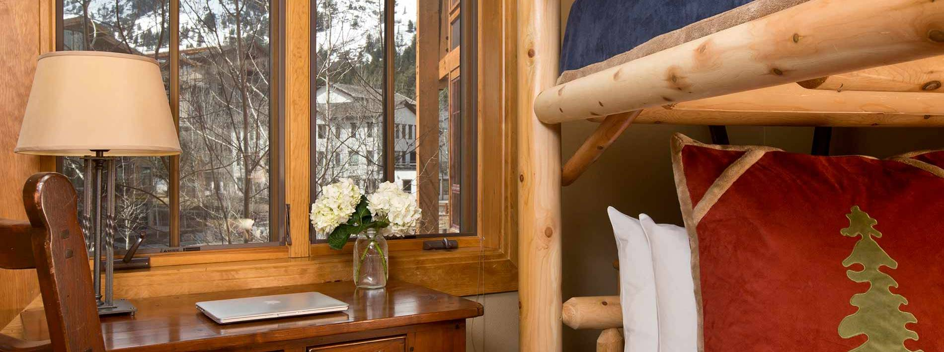 Bunk bed bedroom with large windows