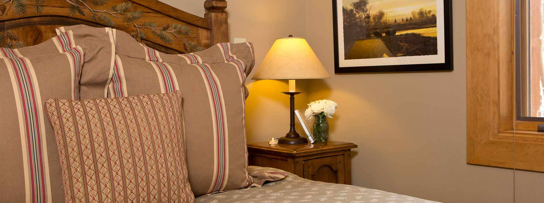 Comfortable bed in the Paintbrush private home rental